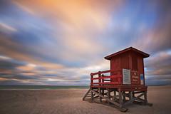 Guardian (andrew_v) Tags: longexposure sunset red beach landscape evening sand nikon unitedstates florida lifeguard shack clearwaterbeach clearwater sandkeybeach nikond800 andrewvernon nikon1735mf28