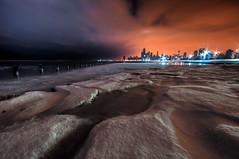 Planet Chicago (matt_frankel) Tags: winter sea orange lake snow chicago tower ice beach wall skyline sunrise dawn illinois nikon long exposure downtown frost michigan sears sigma crater pre hancock 1020mm trump fullerton predawn willis d90
