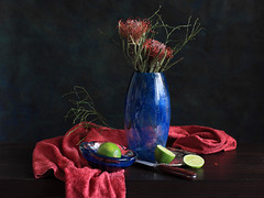 Hungry For A Juicy Life (panga_ua) Tags: flowers stilllife green art floral fruit composition canon reflections spectacular lights juicy artwork shadows darkness artistic availablelight knife ukraine poetic creation fabric imagination drape natalie halves pincushion lime lacy chiaroscuro arrangement tabletop bodegon naturemorte panga artisticphotography rivne naturamorta pincushionprotea artphotography leucospermum darkpink proteaceae sharpfocus twohalves inflorescences juicylife blueglassvase blueglassbowl woodentabletop spideryflowers  nataliepanga pastelsbackground prominentstyles hungryforajuicylife halvesoflime