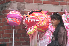 Posing with the Pink Dragon (shaire productions) Tags: sf sanfrancisco california pink woman lady female asian photography photo chinatown dragon image chinese chinesenewyear event photograph imagery