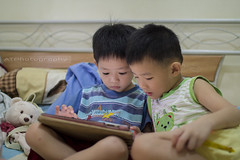 Kids nowadays (GI) (AT.Photography) Tags: life light boy shadow portrait playing game smart childhood closeup kids print children photo amazing bed lowlight asia little bokeh room chinese indoor age staring share naturalight 3514 ipad 35l 2013 60d