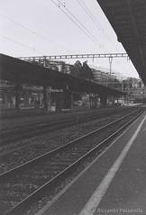 Lugano Train Station (Panda.*) Tags: blackandwhite bw film train lens prime switzerland ticino minolta sony platform 7 railway delta sbb 400 roll dynax alpha expired lugano ilford maxxum ffs cff sal50f18
