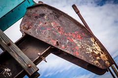 Rusty Oil Pump Head (Mabry Campbell) Tags: usa art industry rural fun photography design countryside photo energy colorful december pumps texas photographer unitedstates unitedstatesofamerica wells well pump photograph 200 oil playful f11 ef2470mmf28lusm crude humerous oilwells pumping oilwell luling oilpump 70mm 2011 reciprocating oilpumps funthings texascountryside ¹⁄₁₀₀sec december282011 mabrycampbell 201112286530