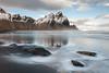 Vestrahorn (Kristinn R.) Tags: sea sky mountains reflection beach clouds iceland nikon stones vestrahorn d3x nikonphotography kristinnr