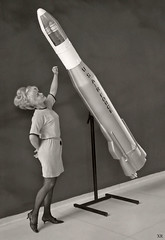 ... woman with model of Atlas ICBM (x-ray delta one) Tags: america vintage advertising poster media russia propaganda aircraft nazis hitler sac nuclear nostalgia 1950s ww2 atlas americana falloutshelter civildefense capitalism bigbrother atomic populuxe nato leningrad stalin coldwar worldwar2 aerospace atomicbomb ussr worldwar1 fallout icbm airtoair strategicaircommand communisim departmentofenergy ww3 worldwar3 greatpatrioticwar atomicwar warsawpact hydrogenbomb b48 thermonuclearwar kiloton nucleardeterent b48tornado atomicannihilation atomicairplane