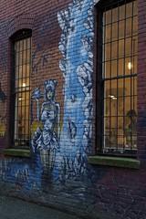 Coffee shop graffiti (Getting Better Shots) Tags: windows building brick graffiti evening coffeeshop