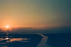 the end of a day (sabenklu) Tags: sun color film wet set 35mm nikon kodak f14 taiwan swamp land taichung reversal aerogenerator f3hp e100 kaomei