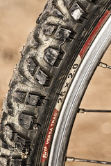 Triumph requires traction -[ HMM ]- (Carbon Arc) Tags: macromondays summerolympicsports knobby bicycle tire tyre wheel spokes olympic sport game mountain biking dirt trail bike outdoor