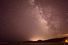 Cala Gonone Milky Way (oliko2) Tags: calagonone milkyway beach sea mountain coast italy nikond7100 longexposure night lights water stars sky buemarino rawtherapee
