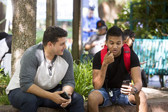 Nathaniel Baba, left, a civil engineering major, and Jasneel Bains, a business major, take a break in the shade of the Library Quad. (Sac State) Tags: public affairs california state university sacramento vernone sacstate sacramentostate calif usa us