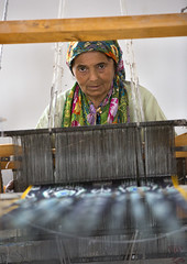 weaving Atalas pattern with silk on the loom, Xinjiang China (Eric Lafforgue) Tags: china travel portrait people woman industry tourism smiling vertical scarf person photography clothing day muslim traditional headscarf working chinese craft indoor textile uighur xinjiang silkroad oldwoman worker daytime inside uyghur weaver cloth minority weaving weave anthropology oneperson loom silkfactory ethnicity onepeople sociology peoplesrepublicofchina autonomy dayview turkic humanright uygur ouigour seniorwoman lookingatcamera colorpicture adultonly colourimage 1people ethnicgroup xinjiangprovince colourpicture xinjianguyghurautonomousregion traditionallychinese easternandcentralasia turkicethnicgroup uygurethnicity atalaspattern eti0717