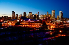 Focus on the Saddledome (John in Calgary) Tags: city blue sunset red sky urban white canada calgary canon saddledome flames arena alberta jpandersenimages