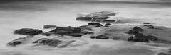 Altered reality (eddieELM) Tags: longexposure sea blackandwhite bw white black beach water rock stone canon eos rocks australia spray queensland 52 hss 600d 2013 canoneos600d