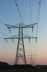 Transmission tower at sunset (PlannedCity) Tags: sunset holland zonsondergang europe steel thenetherlands pylon electricity flevoland almere electricitypylon hoogspanningsmast hydrotower transmissiontower