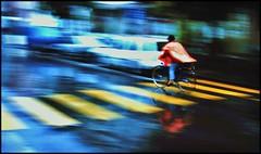 Whizzing Swiss. (dlanor smada) Tags: rain cyclists switzerland capes interlaken unterseen ashowoff