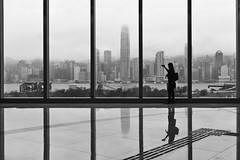 Framed (boingyman.) Tags: travel bw hk white black building window skyline skyscraper canon hongkong cityscape framed wife kowloon icc ifc wifey 1022 t2i boingyman