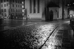 streets of zurich (Toni_V) Tags: street city bw monochrome rain night reflections schweiz switzerland blackwhite zurich zürich regen stadthaus fraumünster 2013 35mmf14asph iso2500 ©toniv 130202 leicam9 l1010737