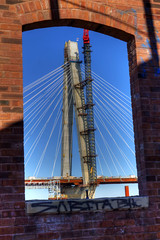 New Missippi River Bridge Window (illusionsofgrandeur) Tags: road county new bridge winter shadow red usa house brick window water st wall architecture work project river mississippi cord illinois construction highway midwest hole suspension steel stlouis engineering cable structure il mo pump american missouri clair cablestayed
