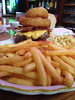 onion rings on the burger fries on the side