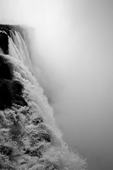 Torrent (Universal Stopping Point) Tags: bw sun mist argentina monochrome river waterfall falls backlit iguazu