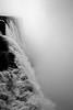 Torrent (Universal Stopping Point) Tags: bw sun mist argentina monochrome river waterfall falls backlit iguazu