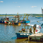 Fishing boats and the ferry to Hurst Castle in Keyhaven Harbour thumbnail
