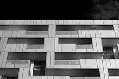 Geometry (Cris Ward) Tags: uk sky blackandwhite bw building london monochrome lines architecture modern contrast silver walking square 50mm prime grey daylight britain geometry sony landmark monotone symmetry fixed daytime alpha angular amateur rectangle asymmetrical height feature greyscale dlsr a450 50mmdtsam