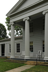 Columns, Avery-Downer House  Granville, Ohio (Pythaglio) Tags: avery downer averydowner house dwelling residence historic greek revival splendid 1842 ohio granville licking county twostory frame grey painted gray 66 windows pediment pedimented portico columns fluted ionic capitals volutes cornice architrave frieze entablature crossettes tapered trim mutules triglyphs sandstone steps sidewalk rocking chairs trees grass lic115 79001877 national register places nrhp