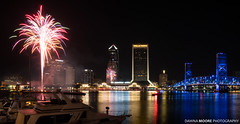 Fireworks over Downtown Jax, Jacksonville, Florida (DawnaMoorePhotography) Tags: lovefl dark fl florida photography tourist acostabridge afterdark atnight bluehour citylights cityskyline dawnamoorephotography dawnamoorephotographycom destination downtown dusk evening fireworks image jacksonville jax lowlight night photo photograph picture reflection riverwalk stjohnsriver travel twilight waterfountain unitedstates us