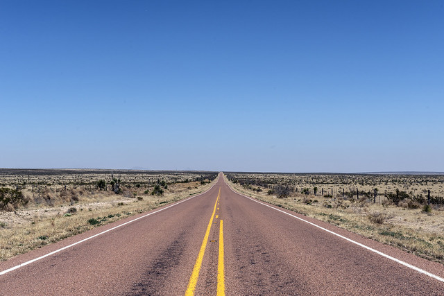 Road leading through desert in Texas