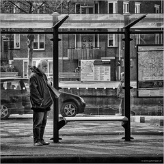 That low-frequent tram service look (John Riper) Tags: johnriper street photography straatfotografie rotterdam square bw black white zwartwit mono monochrome netherlands candid john riper canon 6d 24105 l people window oudenoorden jonker fransstraat noordplein rotte tram stop streetcar glass waiting blues ret map plan car