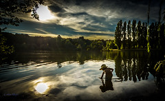 Summer Time (J'AIME...) Tags: water sunset child playing liberty blue clouds landscape quiet sky