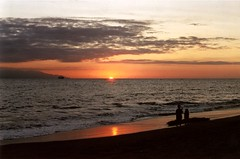 Sunset on Puerto Vallarta Beach Mexico (Song-to-the-Siren) Tags: sunset sea beach mexico pirates driftwood puertovallarta zenit 18 me1 pirateship flockofbirds kodak200 zenit18