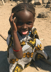 Afar Girl, Assaita, Afar Regional State, Ethiopia (Eric Lafforgue) Tags: africa girls people tongue vertical outdoors child ethiopia oneperson hornofafrica braidedhair traditionalclothing lookingatcamera assaita 78years a700685