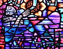 National Cathedral 425 (Nathan_Arrington) Tags: washingtonnationalcathedral thecathedralchurchofsaintpeterandsaintpaul washington cathedral architecturalphotography gothicrevival wisconsinavenue washingtondc districtofcolumbia sculpture glass window detail flower geometric pattern design light shadows stainedglass bright abstract tangle dark interior church religion art history heart sunflower