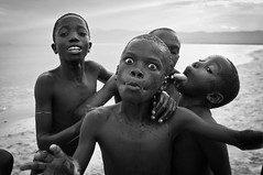 Boys from Kande Beach playing in Lake Malawi (tommcshanephotography) Tags: poverty africa travel lake beach kids children village poor malawi lakemalawi freshwater kandebeach tommcshanephotography