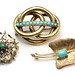 1010. Three Gold and Turquoise Set Brooches