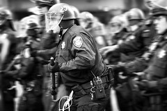 Oakland PD Officers Move Forward Against a Crowd of Protesters, Oakland Riots, 2010 (Thomas Hawk) Tags: california usa oakland riot cops unitedstates 10 unitedstatesofamerica protest police fav20 eastbay riots oaklandpd fav10 oaklandpolicedepartment oscargrant oaklandriots johannesmersehle oaklandriots2010