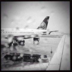 Rainy O'Hare (smaedli) Tags: chicago rain airport aviation iphone uploaded:by=flickrmobile flickriosapp:filter=nofilter