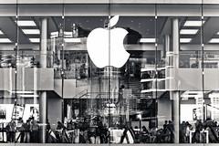 Apple mania (Ksung) Tags: people bw reflection apple glass shop canon hongkong store gloss mania 1755 eos60d