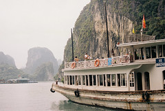 Halong Bay (mayrpamintuan) Tags: ocean travel sea summer sky sun mountain lake mountains green film tourism beach nature water analog asian boats outside outdoors island islands bay boat lomo lomography junk asia vietnamese tour view natural kodak outdoor grain lofi sunny tourist vietnam greens waters grains analogue grainy fujica province lowres halong halongbay ultima junks lowfi citytour fujicast605n kodakultima100 kodakultima flickrtravelaward