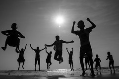 Ya......Hoooooo (kailas bhopi) Tags: jump jumping jumpinggroup silhouette sunset wayangani konkan nikond5100 sun beach outdoor enjoyment energy pointofview action moment kids pose people 1855mm maharashtra monochrome blackwhite performer