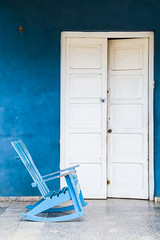 The blue chair [Explored] (images through a lens) Tags: door old travel blue white vintage seat cuba caribbean rockingchair vinales viales republicdecuba