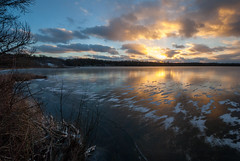 Solid Ice (John Bradtke) Tags: winter light sunset sky sun lake snow reflection ice water colors clouds landscape michigan vivid wideangle lightroom 1024 nikond200