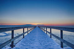 Scandinavian Coldness (Rutger Blom) Tags: blue winter sunset red sea sky orange snow cold ice water evening pier skne dock europe sweden deep freezing sverige 24mm vatten hdr scania oresund zweden resund skane highdynamicrangeimage canoneos5dmarkii ef24mmf14liiusm