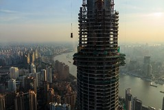 Construction of Shanghai Tower - The Tallest Building in China/2nd Tallest in the World (Maria_Globetrotter) Tags: world china travel sunset sun tourism beautiful skyline canon river boats boat december ship shanghai harbour landmark icon most pudong  kina cina phallus chine largest nga 2012 s