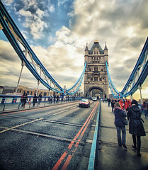 Near Sunset at Tower Bridge in London (` Toshio ') Tags: road blue red england people woman london tower english car clouds towerbridge person europe european angle unitedkingdom sidewalk suspensionbridge europeanunion thamesriver redcar toshio