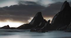 the dark night rises (explored) (yadrad) Tags: beach clouds coast rocks tide nationaltrust southdevon westcombe westcombebeach