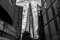 A Distant Shard (Paul Shears Photography) Tags: street city uk blue sky urban blackandwhite bw colour building london tower wet glass rain metal architecture clouds skyscraper buildings londonbridge point evening blackwhite office high alley exposure nightlights view dusk large business tip adobe alleyway massive citylights highrise huge bluehour shard hdr highdynamicrange offices exposures bracketing comunity photomatix photomatixpro hdrsoft lightlights theshard lightroom3