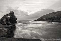 Cliffs at Bundoran Beach (linda_mcnulty) Tags: ocean longexposure ireland sea bw cliff seascape beach water rock strand canon landscape flow bay shore inlet jagged donegal bundoran donegalbay rougey